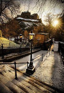 Edinburgh Castle in Scotland high on a snowy hill in early morning light