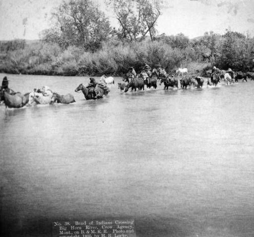 Band of Indians crossing Big Horn River, Crow Agency, Mont.  1895