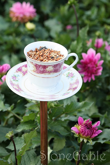 A bird feeder from a china cup and saucer ...  dang!  I just threw away a chipped cup.  Must check the bin!