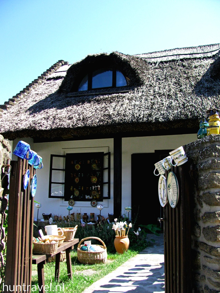 Cottage | thatch roofed cottage in Hungary | Bayer Built Woodworks