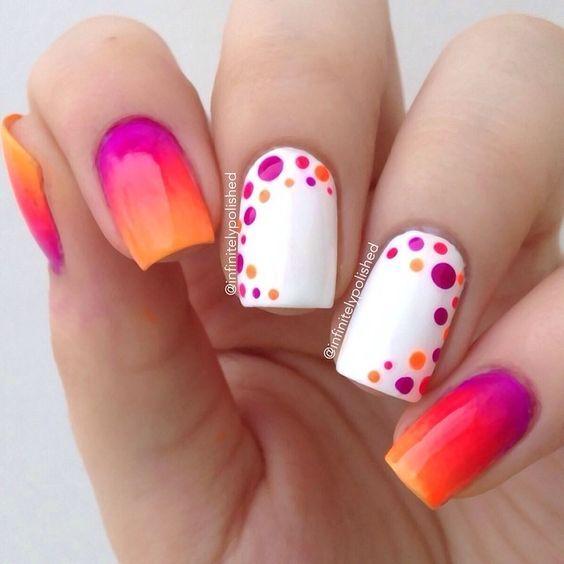 Pretty orange and pink shade with polka dots nail art