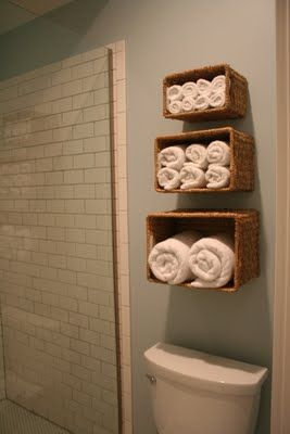 baskets attached to bathroom wall for bath linen storage.: Guest Bathroom, Small Bathroom, Guestbathroom, Great Idea, Towels Holders, Bathroom Storage, Bathroom Idea, Towels Storage, Baskets