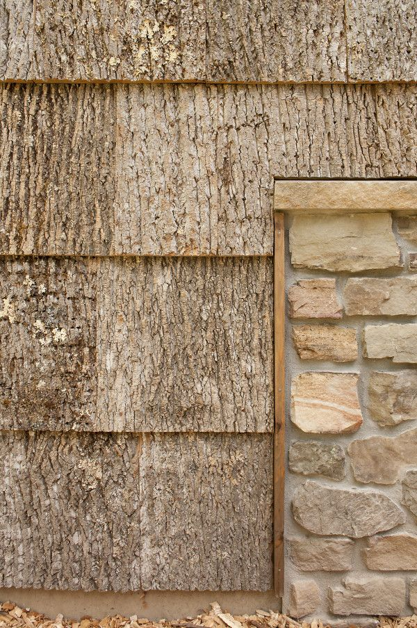compelling contrast between poplar bark shingles and stone