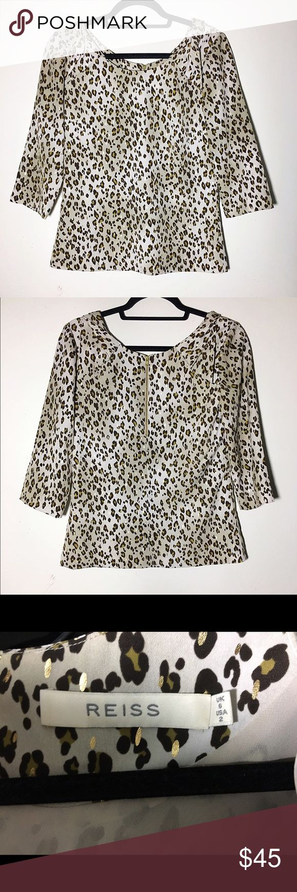 "Reiss metallic leopard 3/4 sleeve blouse 2 Pristine condition. Shoulders have a twisted detail to them. Rear zipper, completely lined. Approx 33"" bust, 23"" length. Shades of brown with metallic gold spots. ✅offers❌trades/PP 💰make an offer on bundles Reiss Tops Blouses"