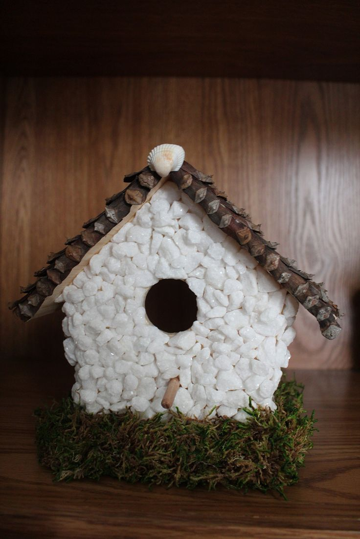 beach style Birdhouse. beach style birdhouse covered in white sparkly stones.