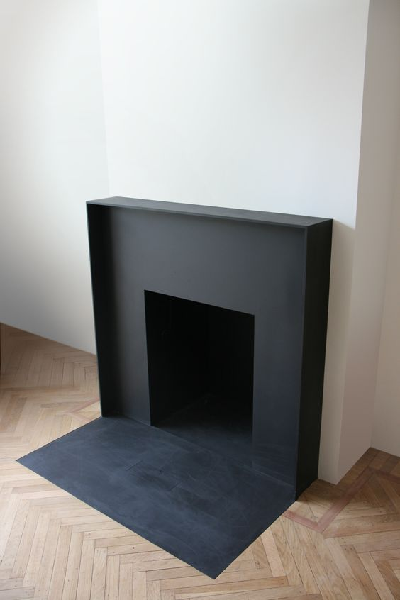 "Minimalistic fireplace. white inner tile. with wood trim and as tall as metal about6-7""wide"