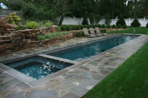 "Lap Pool:  ""One end of this lap pool is walled off to create a hot tub. The layout provides twice the functionality without the need for a space-swallowing footprint."""