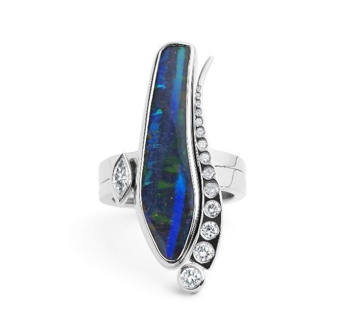 Set of two rings in Boulder Opal and Diamond. A fiery blue boulder opal double ring in 18ct white gold with a marquise diamond detail and a graduated run of round diamonds. David Fowkes Signature Opal Collection. | via dfjewellery.co.uk