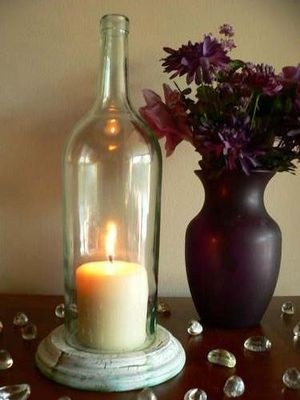 DIY wine bottle candle holders - buy round pre cut pine wood base from Bunnings and paint.  Cut bottom off wine bottle using string dipped in alcohol to wrap around bottom, light and then plunge into cold water. Sand off the edges.