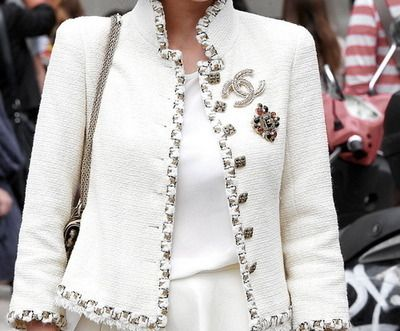 Gorgeous Chanel jacket. I think the CC brooch is overkill.