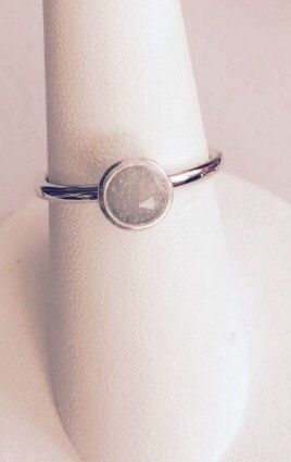 This 14k WHITE GOLD ring is simplistic and goes well with other jewelry. The band is approx. 2 mm and the bezel setting holds approx. 4 mm of