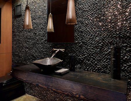 Black Standing pebble wall in restaurant bathroom