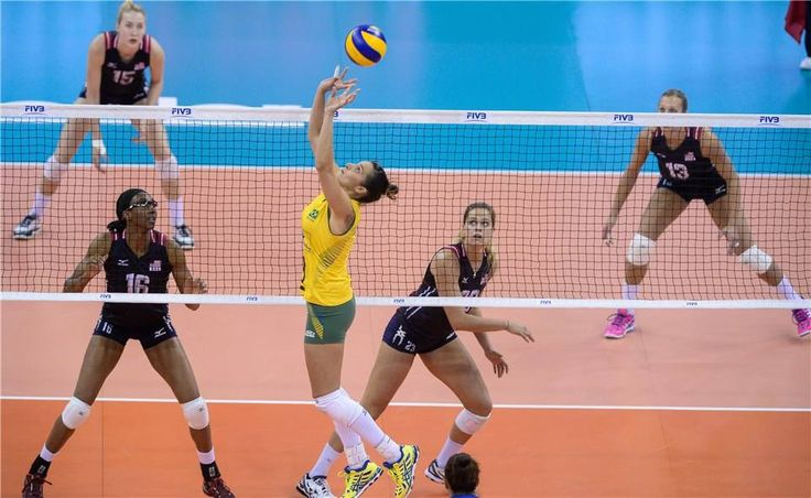 Dani Lins sets for Brazil as the USA gets ready to defend during their FIVB World Grand Prix Finals match.