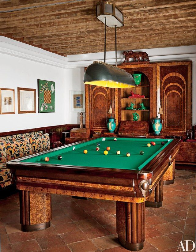 The billiard room's 17th-century ceiling hosts a Rovatti pendant light; the Brenno del Giudice armoire is from the 1930s, as is the pool table | archdigest.com