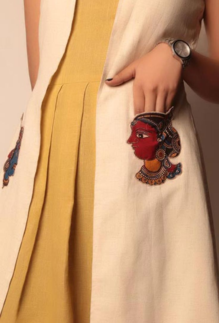 "Khadi cape with Kalamkari patchework on the pocket Dimension: Available in size XS, S, M, L, XL, XXL & XXXL Length of the Jacket : L: 39 Inch Color: Beige Lining: Yes Finish: Handcrafted Material: Khadi Inspiration: Kalamkari Please note : Model is 5'7"" and is wearing size small & these are custom designed apparel and can be exchanged for any size related issues, not eligible for returns"