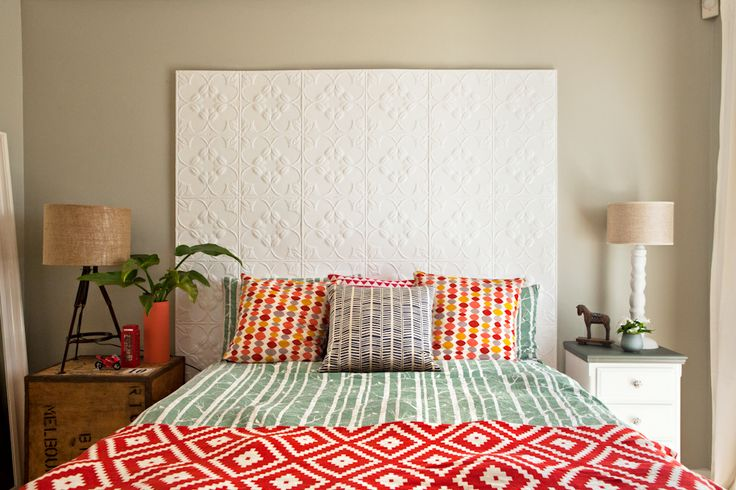 """Maya's bedroom - A quirky retreat with pressed tin headboard, His and hers bedside tables, linen bed cover from Moochie Lou. and statement light pendant. Walls painted with Dulux """"Still"""" in half-strength."""
