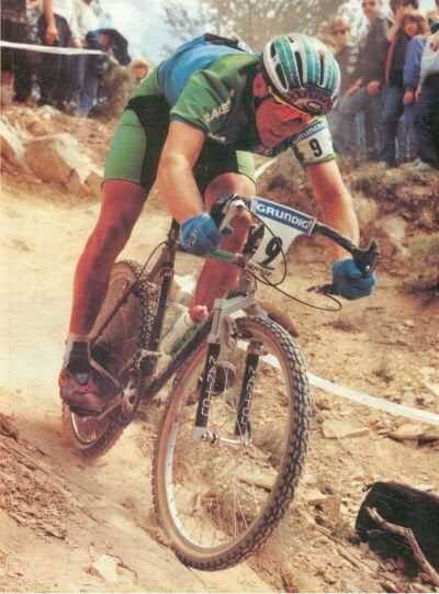 That's John Tomac riding his Raleigh mountain bike with one of the first Manitou suspension forks and a drop bar!
