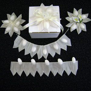 2 Flower OR Star Shape Coccarde almond holder pull-string ribbon is 10 yards. It can be used as a decoration with or without almonds. The roll has