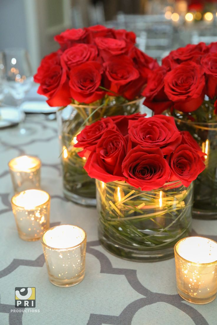 Classic red rose centerpieces and Antique Silver Votive candles are a simple yet beautiful combo for this black tie event.