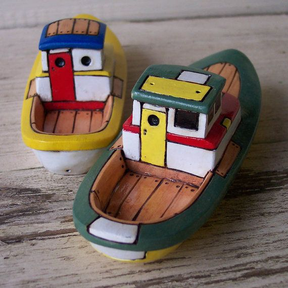 Wooden Toys Boats - do kids really play with stuff like this?  Mine will. :)  Or I'll make him.