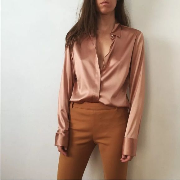 """Ann Taylor Peach  Satin Shirt size 12 Button Front Ann Taylor Peach Silk Satin Shirt size 12 Button Front <<<<<<<<<<<<<<<<<<<<<<<<<<<<<<<<<<<<<<<<<<<  good condition, no stains or holes  button front closure french cuffs 91% Silk 9% Spandex dry clean only  size 12 28"""" long 20"""" across chest laying flat 16"""" shoulder width 25 1/2"""" sleeve length Ann Taylor Tops Button Down Shirts"""