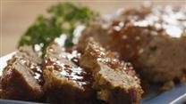 Sour cream is added to this ground beef meatloaf, along with dehydrated beef onion soup, Parmesan cheese, and Italian-style bread crumbs.