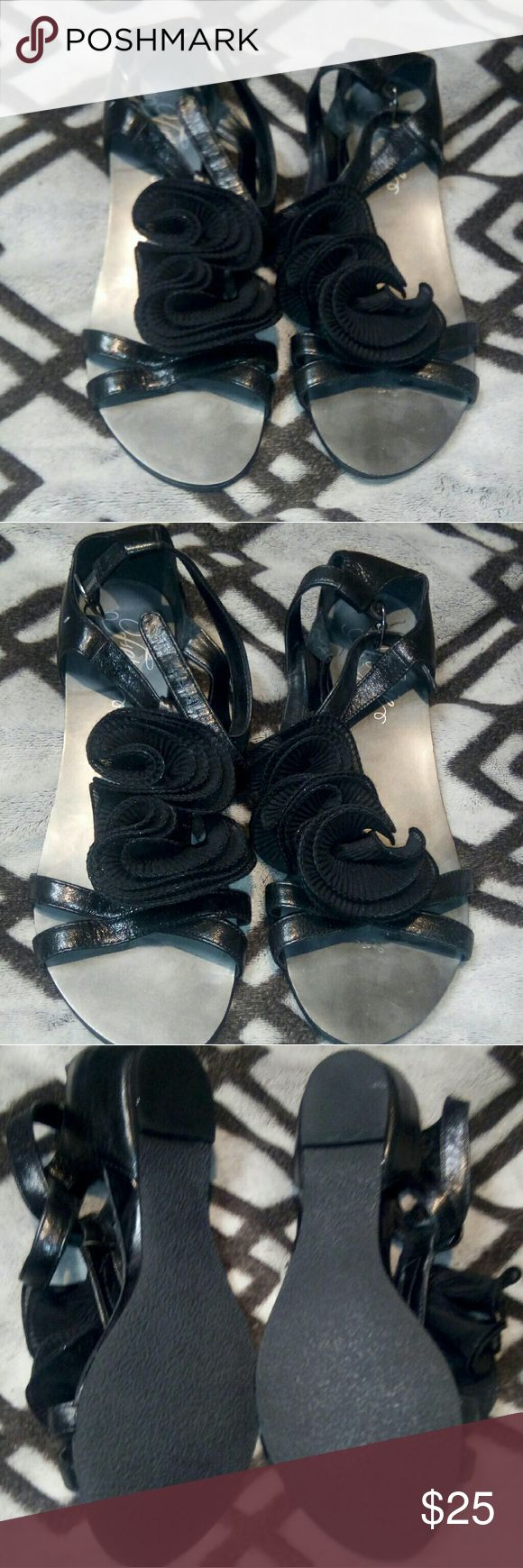 """Fergie Isotope black sandals Chic and casual.leather upper.heel height of about 1"""".Also features buckles.ankle straps.open toe.ruffles detail.in great condition.size 7M. Fergie Shoes Sandals"""