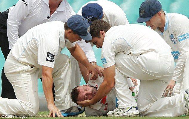 Sean Abbott caring for Phillip Hughes