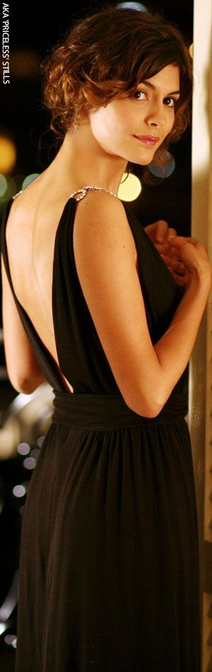 audrey tautou. open back black dress.