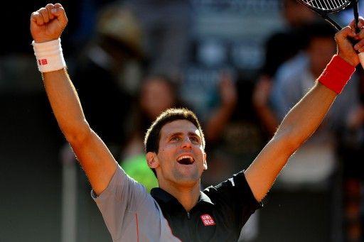 テニス、イタリア国際(Internazionali BNL d'Italia 2014)、男子シングルス準決勝。勝利に歓喜するノバク・ジョコビッチ(Novak Djokovic、2014年5月17日撮影)。(c)AFP=時事/AFPBB News