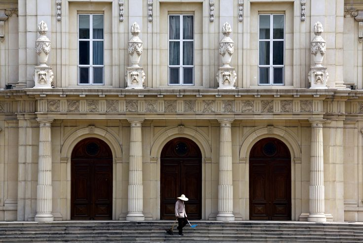 A cleaner works in front of a building that makes up the luxurious Chateau Laffitte Hotel, an imitation of the 1650 Ch�eau Maisons-Laffitte by the French architect Fran�is Mansart, located on the outskirts of Beijing August 20, 2010. In 2004, when the hotel was under construction, the owners were accused of forcing local farmers off their land, and offering them low-paid jobs as compensation. China's richest citizens are even wealthier than the statistics suggest, and may hold as much as…