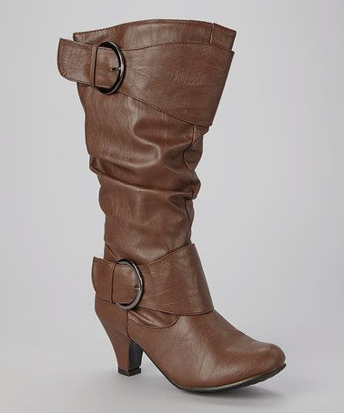 This Brown Darlene Boot by Ositos Shoes is perfect! A sizable heel gives your look a feminine boost, while the slouchy silhouette provides modern allure.   3'' heel 12.5'' shaft 14.5'' circumference Side zipper closure Man-made vegan cruelty free