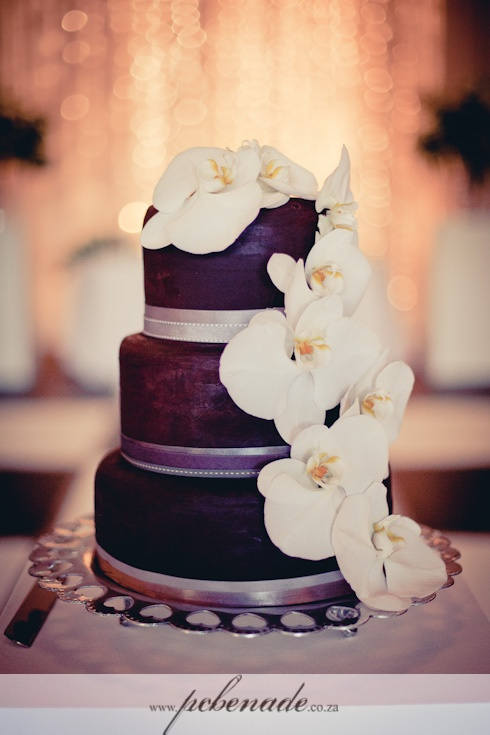 purple #wedding #cake garnished with phal orchids