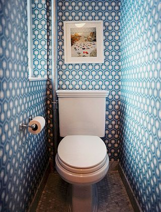 Interesting wallpaper makes an extra small washroom look extra fab