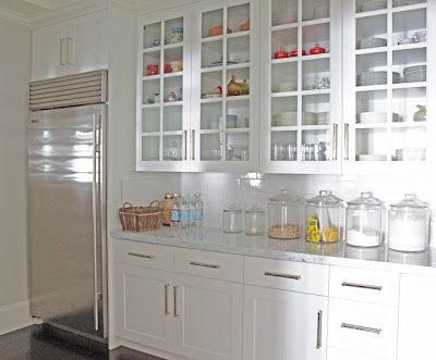 I heart this -- especially the large, round storage things on the counter. Would be great for funky pasta shapes and colors.
