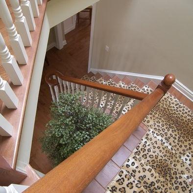 Hardwood Stairs W White Trim And Animal Print Accent Carpet