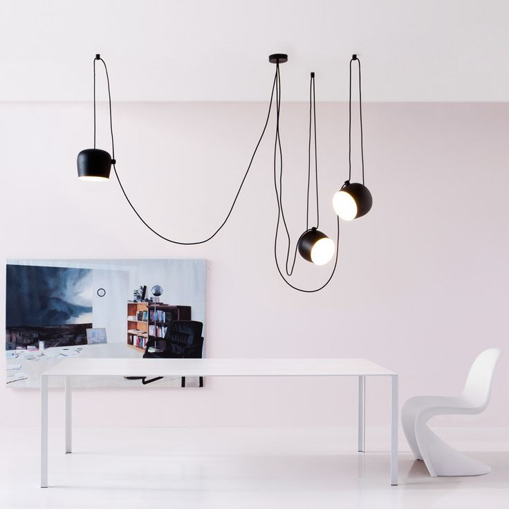 Flos+Aim+Small+Pendant+Light+-+Black+-+Long+looped+cabled+pendant+light+with+black+polished+aluminium+finish. Elevate+your+interior+in+true+minimalist+style+with+the+Flos+Aim+Small+-+Black. A+contemporary+addition+for+above+your+arm+chair+in+the+living+room+or+delight+focal+point+for+above+your+dining+table,+Aim+is+a+functional+addition+for+both+classic+and+contemporary+interior+spaces. Made+from+matt+black+photo-etched+optical+polycarbonate,+the+bucket-like+lamp+shade+cocoons+an+internal...