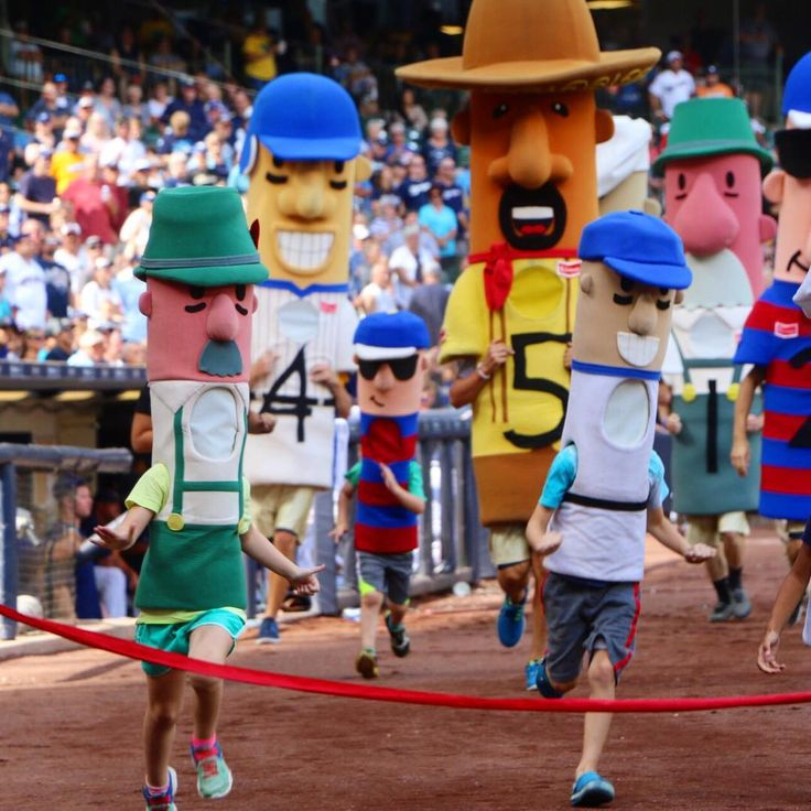 Best Day Ever for my 7-year-old: she got to dress as a bratwurst and run around a baseball stadium in front of thousands of screaming fans. (She's the one on the left.) 😂 #racingsausages #milwaukeebrewers