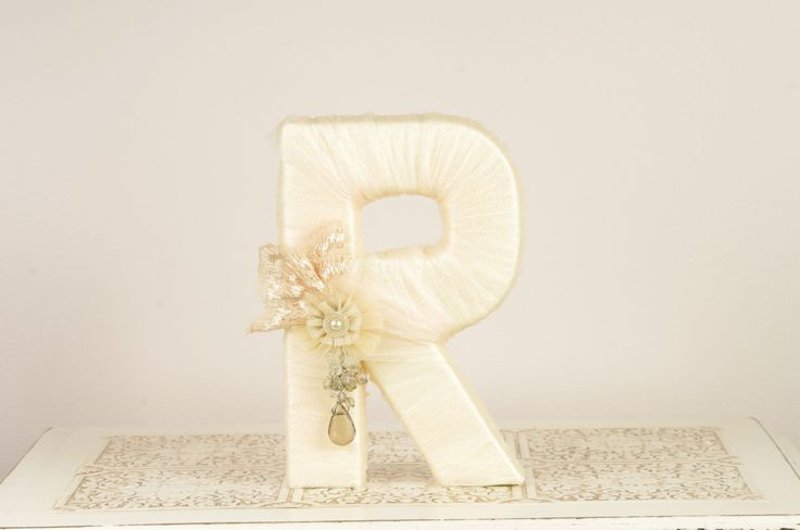 "As Seen in BRIDES magazine UK - Ivory Tulle wrapped letter ""R"" - Wedding Decoration - Table Centerpiece - Cake Topper - Photography Prop. $30.00, via Etsy."