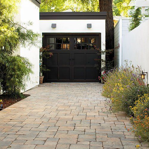 """Those pavers <3 """"Durable concrete pavers set in a regular pattern are a good match for the architectural style of the house, and their subtly varied colors help mediate the starkness of a black-and-white color scheme."""" (Sunset Magazine via SFGate)"""