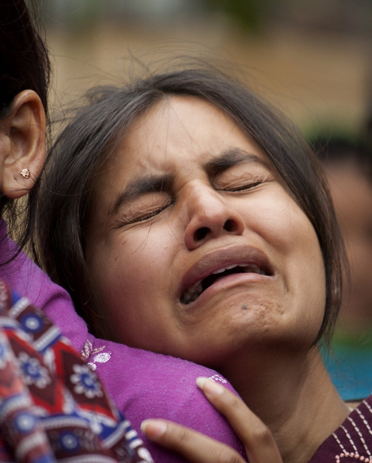 A family member of slain Christian leader Shahbaz Bhatti mourns, outside his home in Islamabad, Pakistan on Thursday, March 3, 2011. Hundreds of Christians demonstrated against the slaying of a Catholic government minister who had long been their most prominent advocate in the Muslim-majority country demanding justice. (AP Photo/B.K.Bangash): Slain Christian, Ap Photo B K Bangash, Christian Leader, Christian Demonstrations
