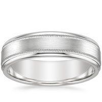 A stylish band with contemporary detail, this distinctive 6mm ring features a soft matte finish balanced with two high polished grooves and light-catching beveled edges. The interior has a rounded inside edge for increased comfort. Due to the width of this ring, we recommend ordering one 1/2 size up for the best fit.