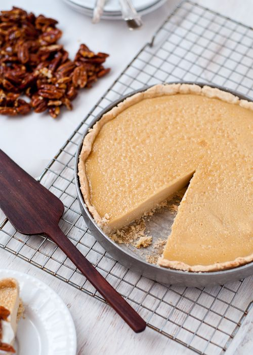 Recipe for gluten-free maple custard tart topped with Greek yogurt and candied pecans. Perfect for Thanksgiving or the holidays.