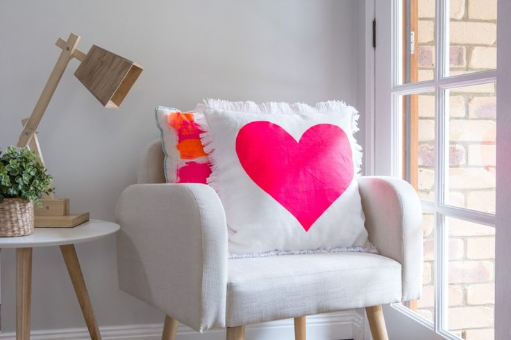 A fun and easy way to create a fun and quirky little corner to encourage you to relax... love this bright pink heart pillow.