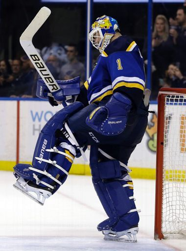 St. Louis Blues' Brian Elliott celebrates at the end of an NHL hockey game against the Vancouver Canucks Friday, March 25, 2016, in St. Louis. The Blues won 4-0. (AP Photo/Jeff Roberson)