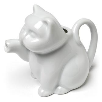 27-CREAMER/CAT - this cat's really got the cream!
