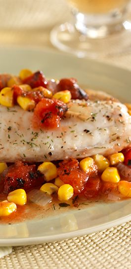 Dill-seasoned tilapia with corn and tomatoes baked in foil packets for a quick and easy meal
