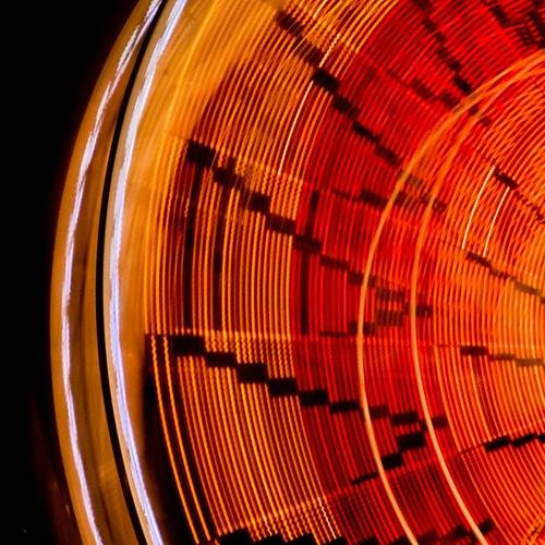 Long exposure image of a ferris wheel