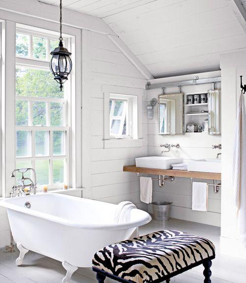 Barn door style mirrors | zebra print ottoman