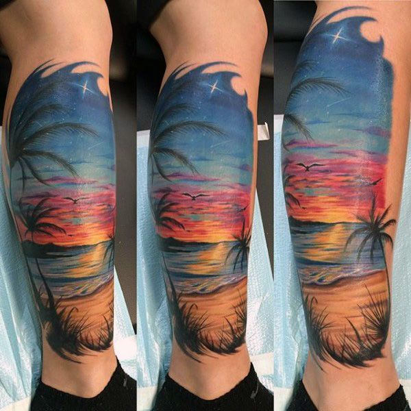 Man With Traditional Beach And Sunset Tattoo On Calf